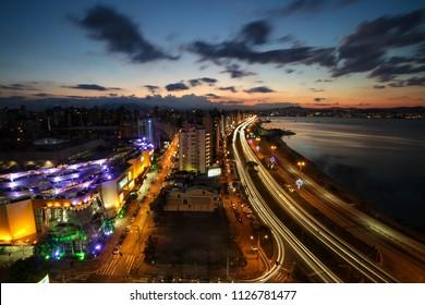 Florianopolis, Santa Catarina, Brazil. Long exposure photograph of night view of downtown and seashore at dusk.