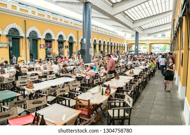 Florianopolis - SC, Brazil - December 26, 2018: Indoors of a popular market in downtown called Mercado Publico de Florianopolis (Mercadao). Touristic Place. People on restaurants of the inside.