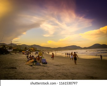 Florianopolis/SC/Brazil - 01-30-2010: People having fun at the unforgettable sunset on the beach of Barra da Lagoa