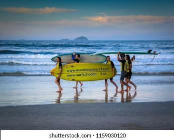Florianopolis/SC/Brazil - 01-30-2010: Teachers of the Surf School of the beach of Barra da Lagoa finishing another day of work