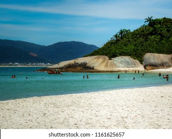 Florianopolis/SC/Brazil - 01-31-2010: Tourists enjoy the sun and turquoise water of Campeche Island, classified by IPHAN as the National Archaeological and Landscape Heritage of Brazil