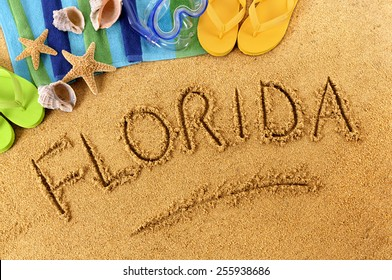 Florida beach : word written in sand.