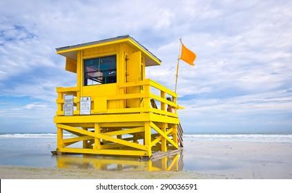 Florida beach yellow lifeguard house on a cloudy summer day  , Siesta Key