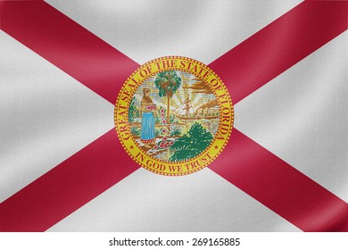 Florida flag on the fabric texture background