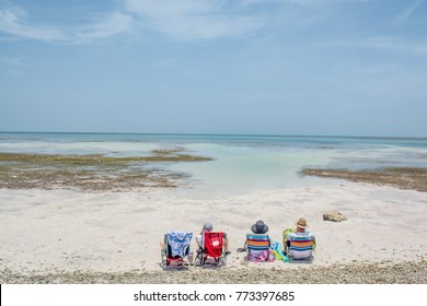 Florida Keys 2015, Anne's Beach, Vacationer's Look out from their Beach Chairs on White Sands at Beautiful Ocean Water and Blue Sky Horizon, Wide Angle
