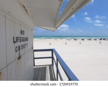 Florida old lifeguard tower with no lifeguard on duty writing and sand beach view