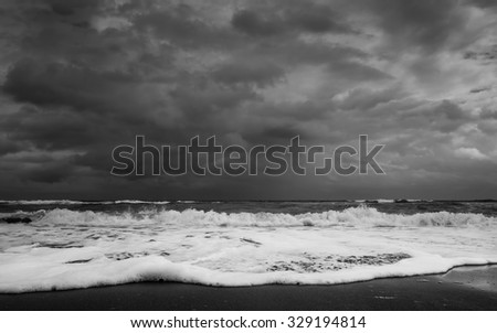 the Florida shoreline on the Atlantic Ocean side right before a major downpour in Black and White