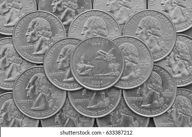 Florida State and coins of USA.Pile of the US quarter coins with George Washington and on the top a quarter of Florida State.