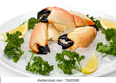 Florida stone crab claws on a bed of ice with lemon slices, and garnished with parsley.