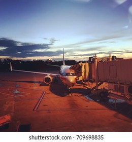 FLORIDA, UNITED STATES - JUNE 26, 2017: American Airlines Boeing 737 with jet bridge connected at Orlando International Airport.