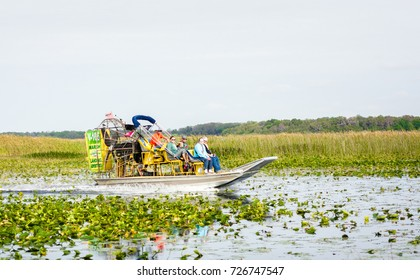 Florida, US - March 13, 2017: Air boat ride with passengers on Lake Tohopekaliga in Kissimmee, Florida.