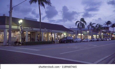 Florida, USA - Circa 2018: Downtown Delray Beach street and shopping strip mall during dusk evening just after sunset on a beautiful summer night