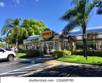 Florida, USA - Circa 2019: Dennys breakfast chain restaurant location exterior in old fashioned diner landmark building. Tropical Florida day time weather view.