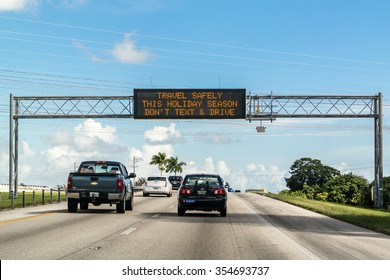 FLORIDA, USA - DEC 14, 2015: Electronic variable message board on matrix billboard on highway warning drivers not to text and drive