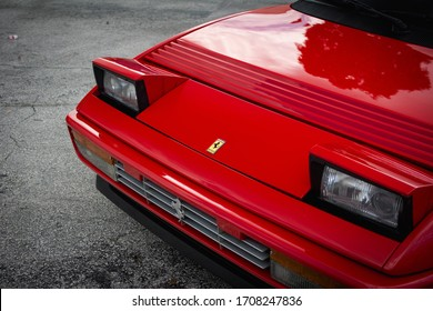 Florida, Year 2019: front of classic red Ferrari Mondial T. Retractable headlights and brand logo.