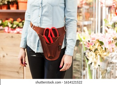 florist girl in holster organizer for floristic tools - Shutterstock ID 1614121522