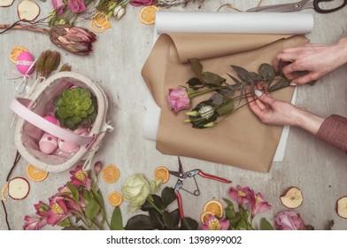 florist girl working in a flower shop