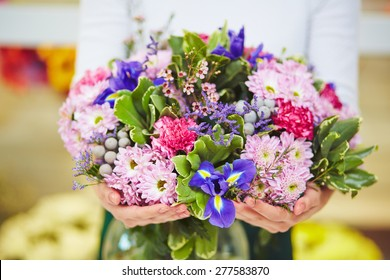 Florist hands with big floral bouquet