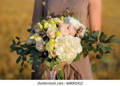 florist holding bouquet colorful flowers shop assistant hands