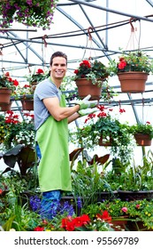 Florist man working with flowers at a greenhouse.