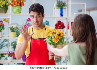 Florist selling flowers in a flower shop