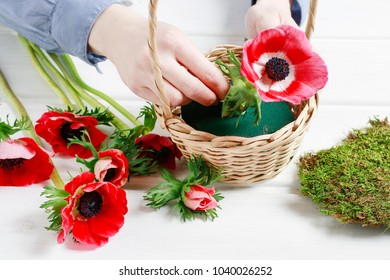 Florist at work: How to make adorable Mother's Day gift with red anemone flowers, moss and wicker basket. Step by step, tutorial.