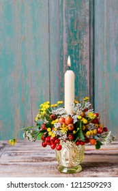 Florist at work: How to make autumn candle holder decorated with rose hip, hawthorn berries and tansy.  Step by step, tutorial.