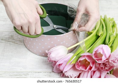 Florist at work. How to make beautiful dotted flower box with tulips. Step by step, tutorial.