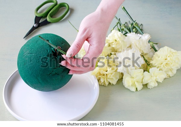 Florist at work: How to make carnation pomander ball, popular wedding decoration. Step by step, tutorial.