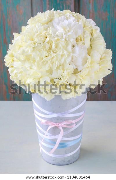 Florist at work: How to make carnation pomander ball, popular wedding decoration. Step by step, tutorial.