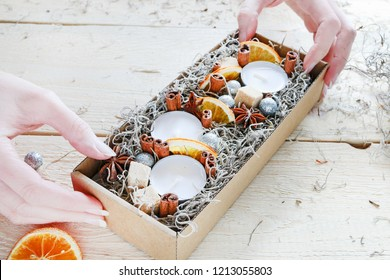 Florist at work: How to make Christmas decoration (gift) in paper box using cinnamon sticks, orange slices and anise stars. Step by step, tutorial.