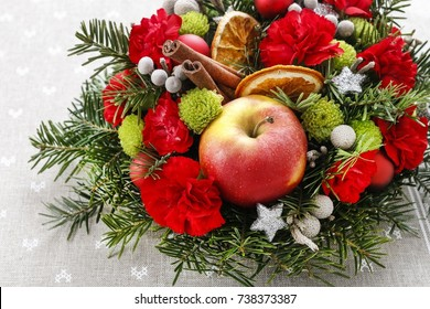 Florist at work: How to make christmas floral arrangement with carnations, chrysanthemum santini flowers and fir. Step by step, tutorial.