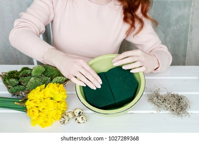 Florist at work: How to make Easter table decoration with daffodils and moss in ceramic bowl. Spring decor ideas. Step by step, tutorial.