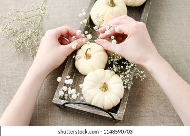 Florist at work: How to make floral decoration with white pumpkins called baby boo and chrysanthemum flowers. Step by step, tutorial.