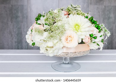 Florist at work. How to make floral decorations for summer party table. Centerpiece with rose, dahlia and hortensia flowers. Step by step, diy.