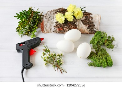Florist at work: How to make simple Easter decoration with egg shell, carnation flower, buxus, chamelaucium and moss. Step by step, tutorial.