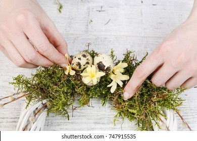 Florist at work: How to make white wicker wreath with moss, quail eggs and hyacinth flowers. Simple easter door decoration.
