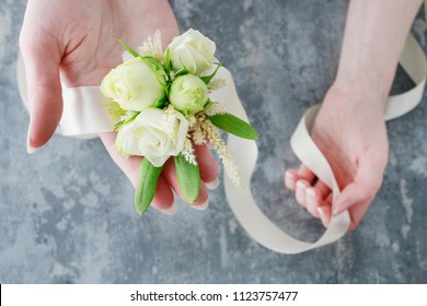 Florist at work: How to make wrist corsage for bride using rose and eustoma flowers. Secrets of making floral jewelry. Step by step, tutorial.