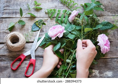 Florist at work. Woman making floral decorations