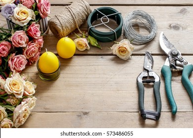 Florist at work: Woman making floral arrangement with roses and candle. Step by step, tutorial.