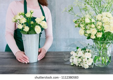 Florist working with roses.