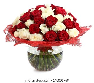 Floristic arrangement of white and red roses. Floral compositions of red and white roses. The isolated image on a white background. Roses in a Glass Vase