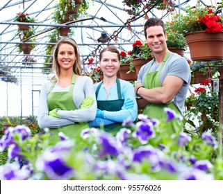 Florists group working with flowers at a greenhouse.