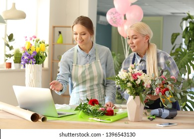 Florists with laptop taking order in shop