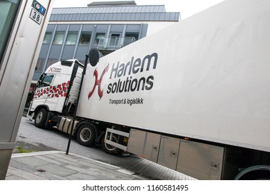 Floro, Norway, July 24, 2018: Harlem Solutions large truck is making a tight left turn in the streets of Floro.