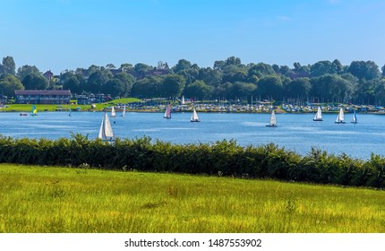 A flotilla of sailing boats on Rutland Water reservoir in summertime