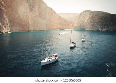 Flotilla of sailing yachts in the bay. Beautiful seascape.