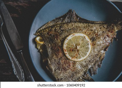 flounder with lemon, top view, toned frame, selective focus