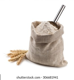 flour in a bag and spikelets isolated on white background.