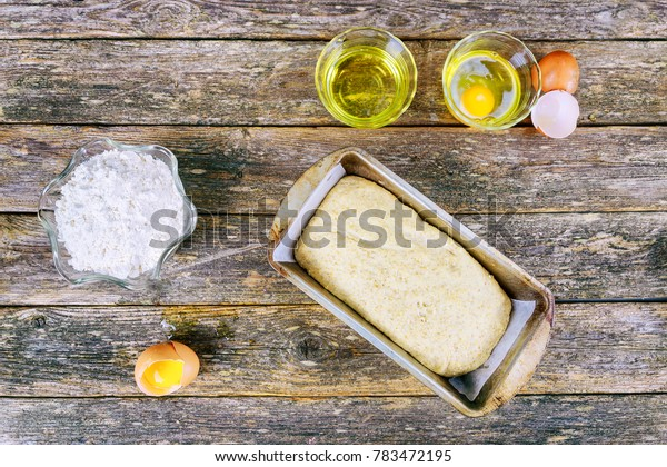 flour baking background with raw egg, rolling pin and wheat ear